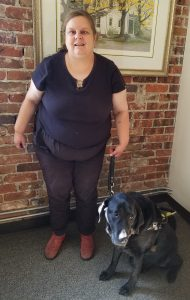 Image of Natalie Orrell and her guide dog named Liam
