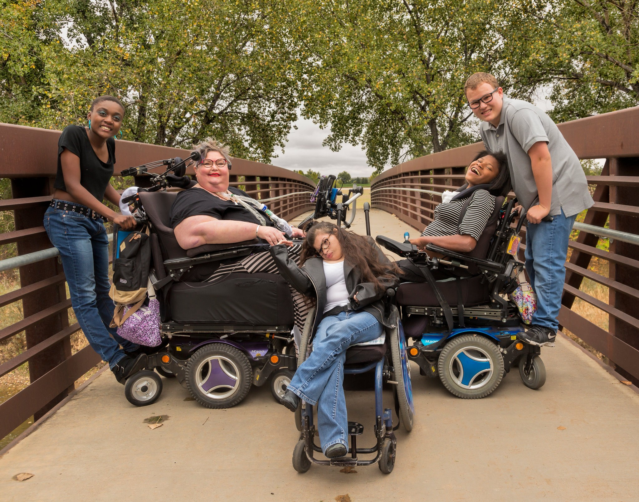 Carrie Ann Lucas, second from left, in 2018 in Windsor, Colo., with her children, from left, Asiza, Heather, Adrianne and Anthony. Ms. Lucas fought for the rights of the disabled, especially those who are parents.