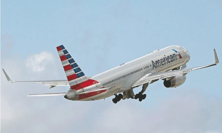 Pictures of an American Airlines airplane taking off,