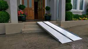 Photo of a home with a portable ramp leading from the top of the steps at the front door to the walkway.