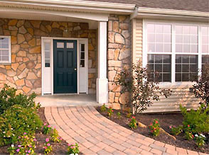 Photo of the front of a home with a zero step entrance.