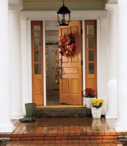 front door of a house that has been decorated for Thanksgiving