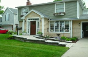 Photo of home with concrete ramp entrance to front door