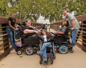 Carrie Ann Lucas, second from left, in 2018 in Windsor, Colo., with her children, from left, Asiza, Heather, Adrianne and Anthony. Ms. Lucas fought for the rights of the disabled, especially those who are parents.Credit...Carrie Ann Lucas