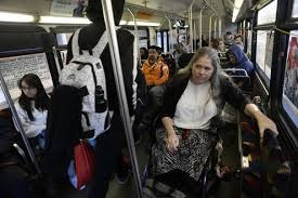 Picture of Julie Reiskin riding a pretty full bus