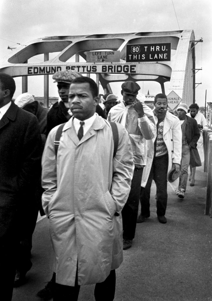 Photo of young Representative John Lewis crossing the Edmund Pettus Bridge
