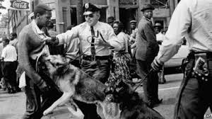 Police and attack dogs attacking marketers who cross the Edmund Pettus Bridge