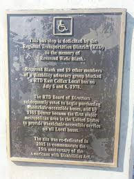 Plaque located at the site where the Gang of 19 protested on Colfax Ave. in Denver, Colorado
