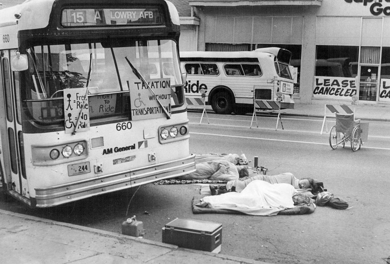 "Image of protesters with disabilities who got out of their wheelchairs to block RTD buses in the 1984 ""Gang of 19"" protest"