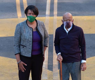 "Washington, DC. Mayor Muriel Bowser and John Lewis wearing facial masks and standing on the letters of ""BLACK LIVES MATTER"" painted on 16th St. in Washington, D.C. courtesy of ""Civil rights icon John Lewis calls Black Lives Matter mural 'a powerful work of art' during a visit with DC mayor."""
