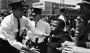 "Images of John Lewis being arrested during nonviolent protests. The picture on the left courtesy of Smithsonian Magazine ""John Lewis' Arrest Records are Finally Uncovered Smart News."""