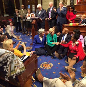 Photo of sit-in protest staged by Congressman John Lewis for the purpose of getting the Senate to pass gun control legislation courtesy of CNN.com Democrats and House sit-in protest over gun control;""