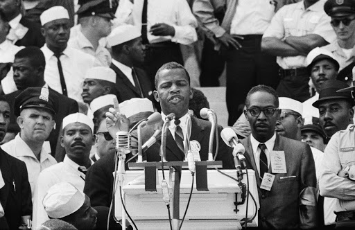 "Image of 23-year-old John Morris speaking at the March on Washington for Jobs in Freedom on August 28, 1963, the same day as the famous ""I Have a Dream"" speech delivered by Dr. Martin Luther King. Photo courtesy of the Washington Post ""At the 1963 March on Washington, civil rights leaders asked John Lewis to tone his speech down."""